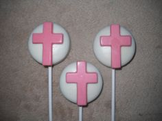 Chocolate THICK Oreo Christening Communion Cross Lollipops Religious chocolate lollipops. castlerockchocolates at yahoo.com 307/899-7100 text any hour www.sapphirechocolates.artfire.com and stores.ebay.com/Castle-Rock-Chocolatier. usually made to ship 3 weeks after payment therefore please provide the following for a price quote w/ shipping info especially if your event falls under the 3 week estimated arrival dates * event date * character * quantity * state * zip code * email address.