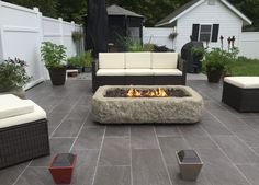 Outdoor porcelain deck in Maine! The fire pit is limestone/fiberglass....lp gas.