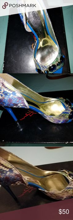 Carlos blue heels worn once Carlos peep toe heels worn once.  Sz 7.   From Macy's  Donated to raise money for my breast cancer fundraising. Carlos Santana Shoes Heels