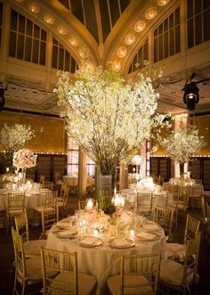 Pretty (and super tall) centerpieces at a New York Public Library wedding. Click for more!