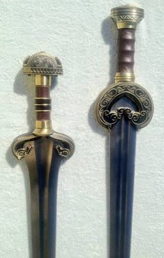 Éowyn's sword (left) and King Theoden's (right). Awesome!