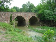 Stone Bridge crosses Bull Run at the eastern entrance of the Manassas National Battlefield Park in Manassas, Virginia. The original bridge, built in 1825, was destroyed during the First Battle of Bull Run on July 21, 1861, the first major land battle of the American Civil War. In 1884, a new bridge, apparently similar to the original design, was built on the site of the old bridge.