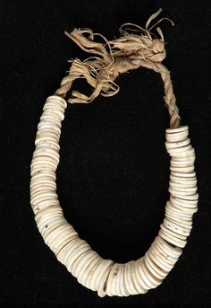 Solomon Islands ~ Isabel Province | A currency necklace | mid 20th century | Shell rings on a woven plant fiber cord.