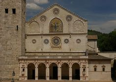 Spoleto - Duomo. Consecrated in 1198 by Pope Innocent lll to replace the original building, destroyed by Frederick Barbarossa in 1155. Portico is from 1491. Four rose windows, two external pulpits and a mosaic by Solsternus dated 1207.