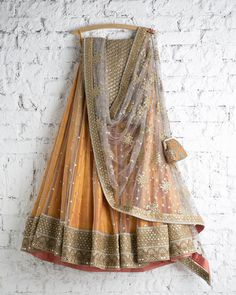 Mustard and Gold lehenga with hand-worked dupatta