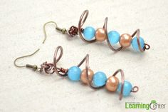 The final look of spiral wire wrapped earrings with DIY instructions.