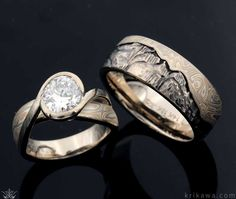 This set includes our Mokume River Twist Engagement Ring and Mountain Mokume Wedding Band. Each is custom made on the metal, mokume and solitaire stone you want. With the Mountain Mokume Wedding Band, we hand-carve your favorite mountain range!