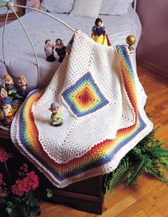 Rainbow Baby Blanket Free Crochet. Speaking of colorful crocheted squares, here's a darling Rainbow Baby Blanket featuring a multi-color center block that could be used as a separate pattern for an afghan square to make charity blankets. You can create squares using as many rounds of the center block pattern as you like. With its cheery rainbow colors and classic design, this sweet blanket is great for either a baby girl or boy and makes a perfect new-mother gift. It would also be beautiful…