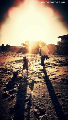 Family playing at the beach. CMO Photography.