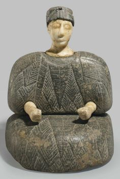 A BACTRIAN COMPOSITE STONE SEATED FEMALE FIGURE   BACTRIA-MARGIANA, CIRCA LATE 3RD-EARLY 2ND MILLENNIUM B.C.