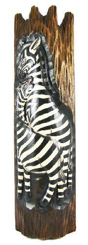 Hand Painted Zebra Wooden Plank Wall Hanging by Private Label. Save 33 Off!. $19.99. Made in Indonesia, this beautiful zebra wall hanging is hand-carved from Indonesian light Albessia wood, and is hand-painted. Measuring 19 1/2 inches tall, 5 1/2 inches wide and 2 1/2 inches deep, it looks great on walls in patios, outdoor tiki bars or any other jungle themed room.This wall hanging makes a great gift for friends and family. NOTE: Since these masks are hand carved and hand pa...