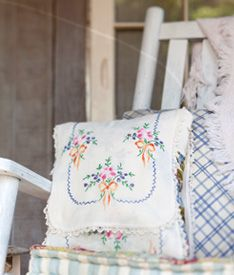 Vintage dresser scarf to pillow --- this link does not work as it was a photo in an email -- but it gives ideas for recycling heirloom dresser scarves and doilies