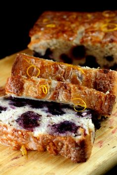 Super Moist Smashed Blueberry Lemon Loaf Cake made with Nonfat Greek Yogurt. You'd never know this cake was 95% fat-free and 100% fat-free using apple sauce instead of oil.
