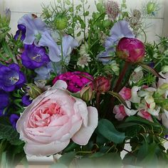 June bouquet with roses, campanula, peony, snaps, sweet peas and herbs.