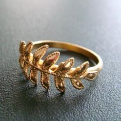 fern gold feather leaf ring from trystbykerry etsy shop: $48
