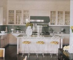 gray & yellow eclectic kitchen design  Cool vintage white faux bamboo metal stools!  Metal faux bamboo bar stools with yellow cushions.