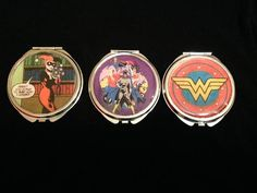 DC Girls Compact Mirror (your choice of one) $15 Harley Quinn Wonder Woman DC Girls Group (Super Girl, Bat Girl, and Wonder Woman) https://www.etsy.com/listing/216392610/dc-girls-compact-mirror-your-choice-of