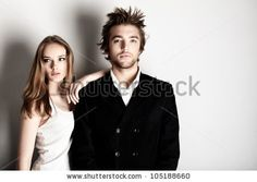 A new version of Over the shoulder...  Shot of a fashionable couple posing at studio. by Kiselev Andrey Valerevich, via ShutterStock