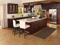 IKEA Ramsjo kitchen in red-brown. I love (almost) everything about this kitchen! Especially the cabinet color. Although I would go with a darker countertop, not a huge fan of the white.