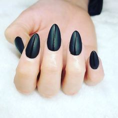 Back to black! We are loving these #mattenails from @notorious_nails_. Yay or nay? #manicure