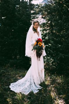 This bride's mother-in-law made this stunning lace gown | Image by Lauren Parker Photography