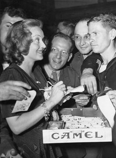 Betty Davis during WWII...Passing out...OMG!!!....Free Cigarettes!!