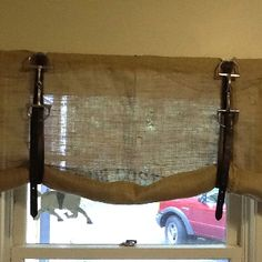 Cute idea for a window treatment and so simple. Burlap, stirrup straps and horse bit! horse barn ideas, horse tack room ideas, horse bit, horse bedroom ideas, horse room ideas, barn windows, window treatments, barn office ideas, barn idea horse