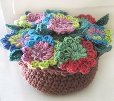 Crocheted Flower Pot  You can find the pattern to make your very own flower pot here at the Crochet Spot Store.  Imagine all of the colours that you could use!  (I think I'll make one for my desk at work!)