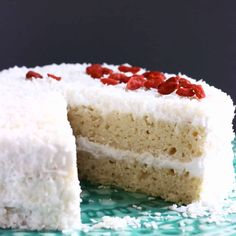 ThisGluten-Free Vegan Coconut Cake is moist and fluffy, sweet and creamy and wonderfully coconutty! Refined sugar free too.