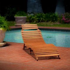 """Lahaina Outdoor Wood Chaise Lounge (816764019093) This attractive chaise lounge easily folds for convenient storage and its curved design makes it a beautiful addition to any backyard environment. sturdy acacia wood construction unique folding feature allows for easy storage and transport S-shaped for ultimate comfort Wood. Rinse with mild soap and water. No assembly required. Measures 21.26x70.86x26.77""""H. Imported."""