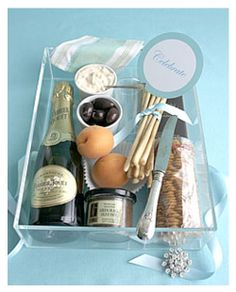 Celebration-snack - Packed full of specialty items such as champagne, crackers & cheese, fruit & chocolate….this gift is sure to put a smile on the recipients face!