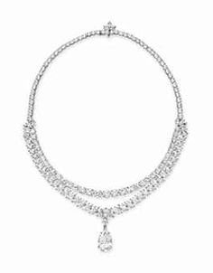 A CONVERTIBLE DIAMOND AND RUBY PENDANT NECKLACE, BY HARRY WINSTON - Designed as a circular-cut diamond neckchain, intersected by marquise-shaped diamond clusters, with two detachable attachments, the first, a marquise-cut diamond line, suspending a detachable pear-shaped diamond, weighing approximately 7.09 carats; and the second, an oval-cut ruby and marquise-cut diamond line, mounted in platinum, 15 ins.,
