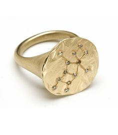 A gold and diamond signet ring depicting the constellation of Virgo. (Kamofie) YES