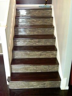 Custom tile and wood stairs. What about taking the kitchen backsplash tiles and doing the stairs with the same kind? Tile Stairs, Basement Stairs, Tiled Staircase, Hardwood Stairs, Staircase Ideas, Wooden Stairs, Spiral Staircase, Decoration Hall, Plafond Design