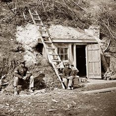 Dutch Gap, Virginia Bomb-proof quarters of Major Strong. It shows two negro soldiers outside a cabin. These men are likely escaped slaves who joined the Union Army 1864. June 1864-April 1865.  they appear to be servants.