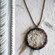 Babys Breath Circle Necklace. Reminds me of my grams. She loves babys breath :)