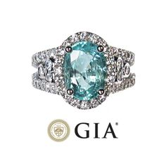 So pretty, love the color! 4.62 ct GIA Paraiba Tourmaline and Diamond Engagement Ring