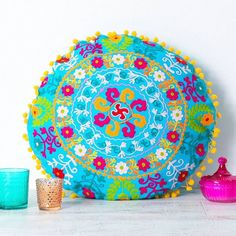 handmade embroidered turquoise round cushion by all things brighton beautiful | notonthehighstreet.com