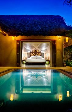 Modern house with bedroom overlooking swimming pool. Go from bed to pool - nice!