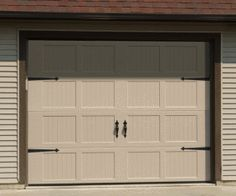 Garage Doors - I'm thinking adding some hardware to the garage doors might be a nice touch too.