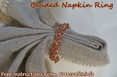 Folded Linen Napkin in a Bead Crochet Napkin Ring. You Can Make This Napkin Ring Using Our Free Crochet Pattern and Detailed Step-By-Step Tutorial.
