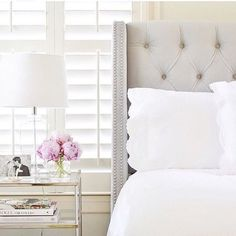 A tufted wingback headboard is a classic bedroom piece that will never go out of style.