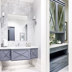 One of our favourite bathrooms we completed for our #projectstreambank home! This floating cabinet is a stunner with a classic herringbone marble mosaic as the feature! A freestanding complimenting linen cabinet is spectacular int he space with its beauty and added storage!! #tapestrydecor #design #decor #details #customhome #customcaninets #bathroom #interiordesign #interior #mosaics #timeless
