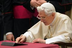 Pope Benedict XVI clicks on a tablet to send his first twitter message during his weekly general audience at the Paul VI hall at the Vatican. Pope Benedict XVI sent his first Twitter message from a digital tablet on Wednesday 12Dec2012, using the handle @pontifex, blessing his hundreds of thousands of new Internet followers