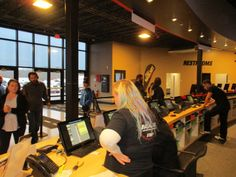 """""""SuperCharged Indoor Go Kart Racing's Friendly Staff Checking In Guests for Their Upcoming Racing Heats and Trampoline Jumping Sessions"""""""