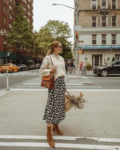 Chunky sweater + midi skirt combo #sweater #skirt #boots #bag #flowers #sunglasses #casual #style
