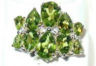 Price $134.60 Free Priority Mail  Stunning Sterling Silver 7.70ctw Pear Shape Peridot with .11ctw Round White Topaz Ring. This ring measures 1116 inch...