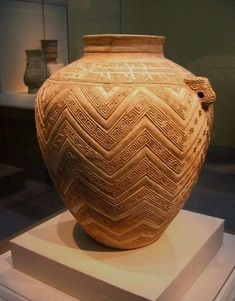 Egyptian pot with a carved geometrical surface.