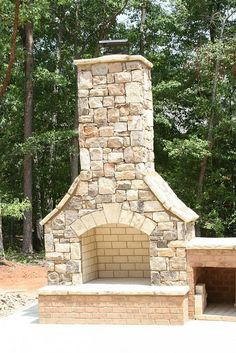 outdoor fireplace - Love the shape of this fireplace. Would probably pick a little darker stone.