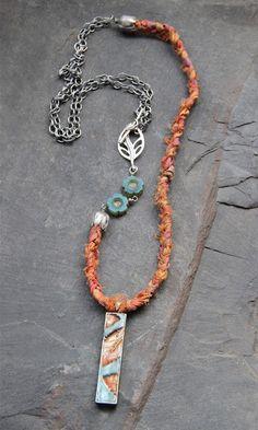 ABS NOV piece with a Tesori Trovati pendant